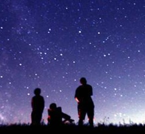 People gazing up at night sky.