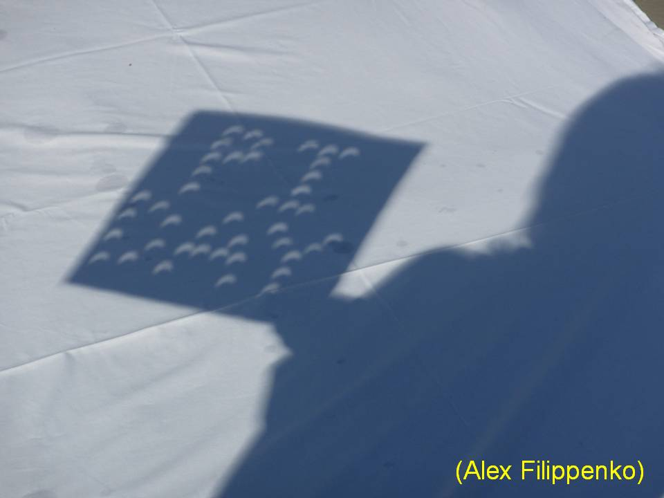 close-up of pi day crescents projected through the cardboard sign