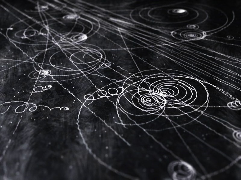 Tracks made by different particles originating from cosmic rays.